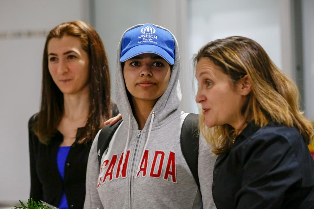 Rahaf Al-Qunun (C) accompanied by Canadian Minister of Foreign Affairs Chrystia Freeland (R) and Saba Abbas, general counsellor of COSTI refugee service agency, arrives at Toronto Pearson International Airport in Toronto, Ontario, Canada on Saturday. — Reuters