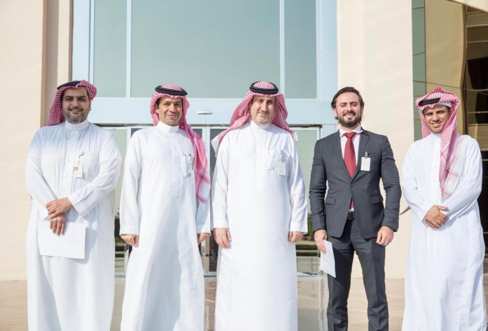 SABIC officials Fouzan Al Shamekh (middle) – Liquid Supply Chain Director, Petrochemicals and Mohammad Al Sahil (second to the left) -  Liquid Supply Chain MEAF Sr. Manager with Khaled Mengash (right) – Customer Service Manager, and Tareq Abanmee (left) – MEAF Customer Service. United Stars Country Manager Aous Mahmoud Ahmed Ali is second to the right at the signing of contract