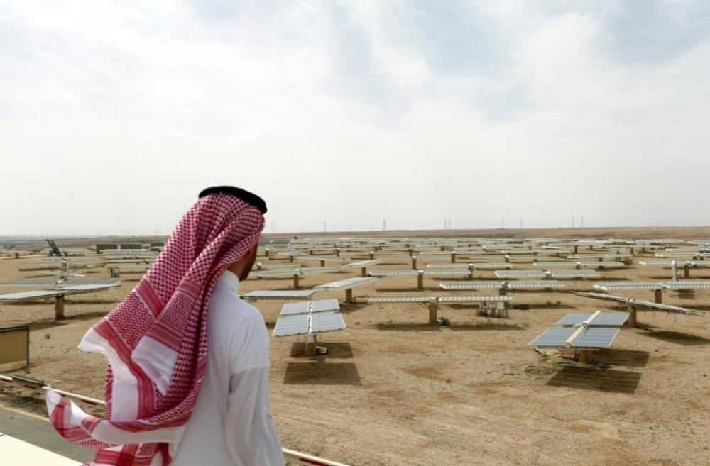 A Saudi man looks at the solar plant in Uyayna, north of Riyadh, in this file photo. — Reuters