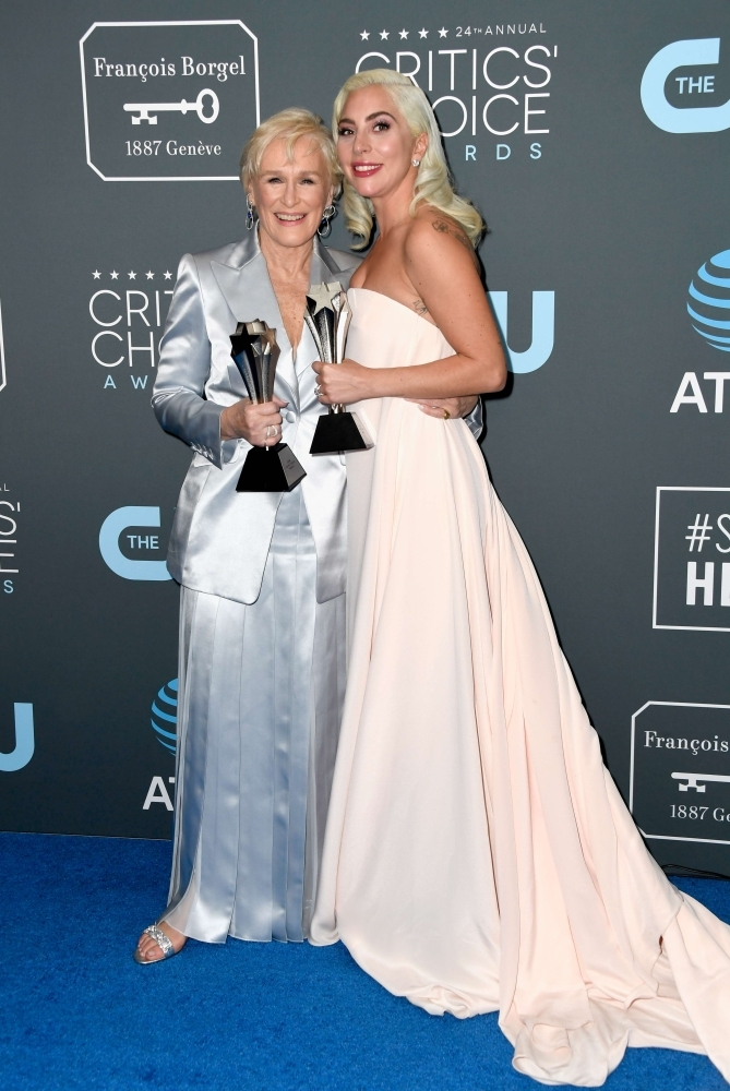 SANTA MONICA, CA - JANUARY 13: Glenn Close (L), winner of Best Actress for 'The Wife', and Lady Gaga, winner of Best Actress for 'A Star Is Born,' pose in the press room during the 24th annual Critics' Choice Awards at Barker Hangar on January 13, 2019 in Santa Monica, California.   Frazer Harrison/Getty Images/AFP