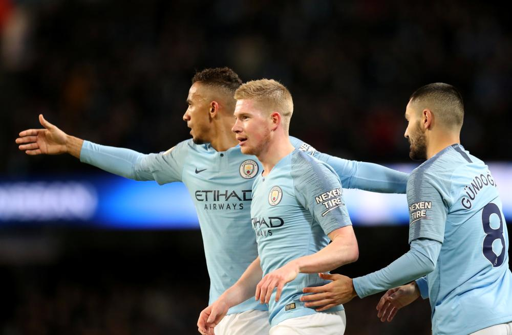 Manchester City's Kevin De Bruyne celebrates scoring their third goal with teammates against Wolverhampton Wanderers during their Premier League match at Etihad Stadium, Manchester, Monday. — Reuters