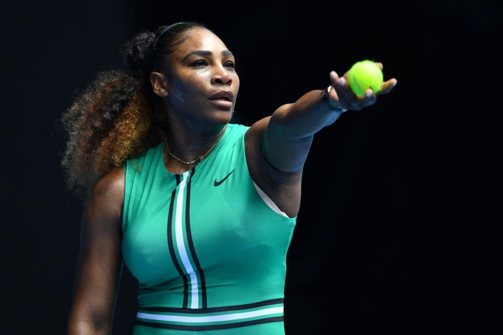 Serena Williams of the US serves against Germany's Tatjana Maria during their match at the Australian Open in Melbourne Tuesday. — AFP