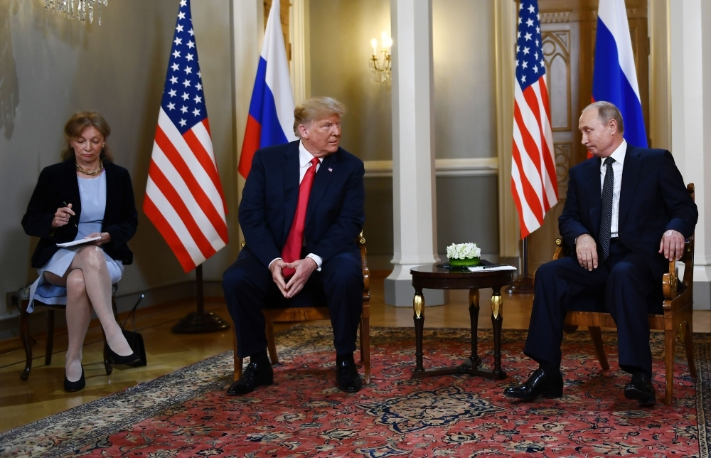 Russian President Vladimir Putin, right, and US President Donald Trump, second left, attend a meeting in Helsinki, in this July 16, 2018 file photo. — AFP