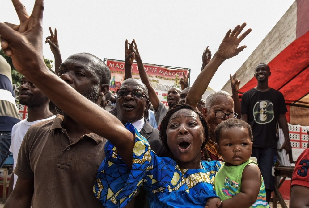 People celebrate in Abidjan on Tuesday after the news that International Criminal Court acquitted former Ivory Coast president Laurent Gbagbo over a wave of post-electoral violence, in a stunning blow to the war crimes tribunal in The Hague. — AFP