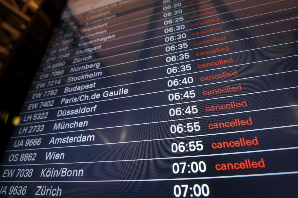 A board displays canceled flights at the airport in Hamburg, northern Germany, on Tuesday. — AFP