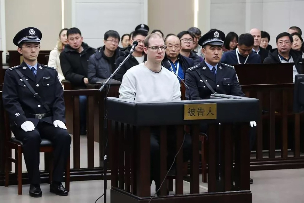 Canadian Robert Lloyd Schellenberg, center, is seen during his retrial on drug trafficking charges in the court in Dalian in China's northeast Liaoning province on Monday. — AFP