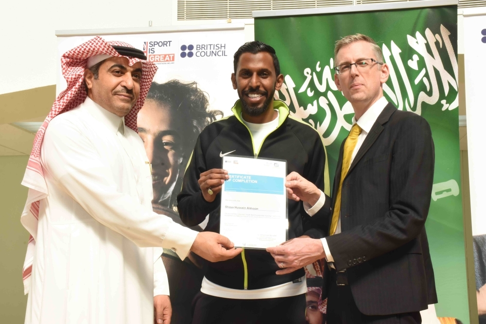 Shaye Aldowayan receives his national trainer certificate.