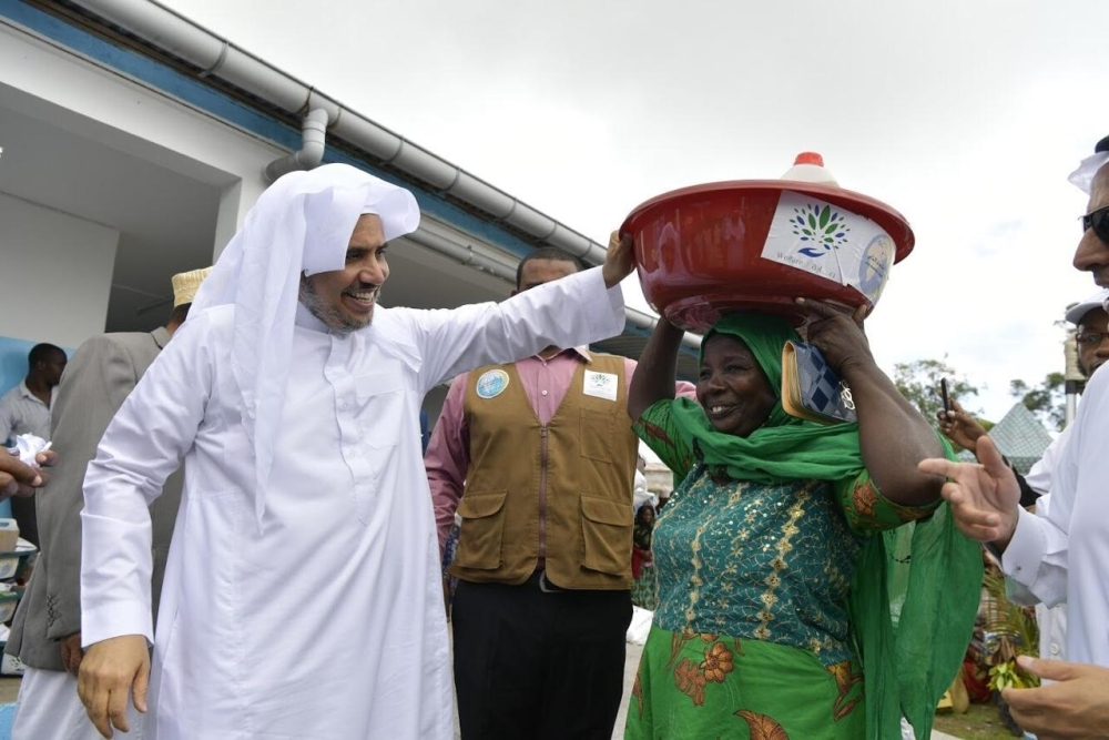 Dr. Muhammad Al-Issa overseeing the distribution of food baskets to the needy.