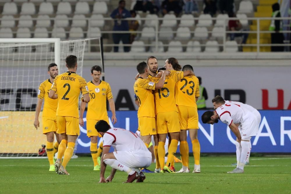 Australia players celebrate their 3-2 win in the 2019 AFC Asian Cup Group B match against Syria at the Khalifa Bin Zayed Stadium in Al Ain Tuesday. — AFP