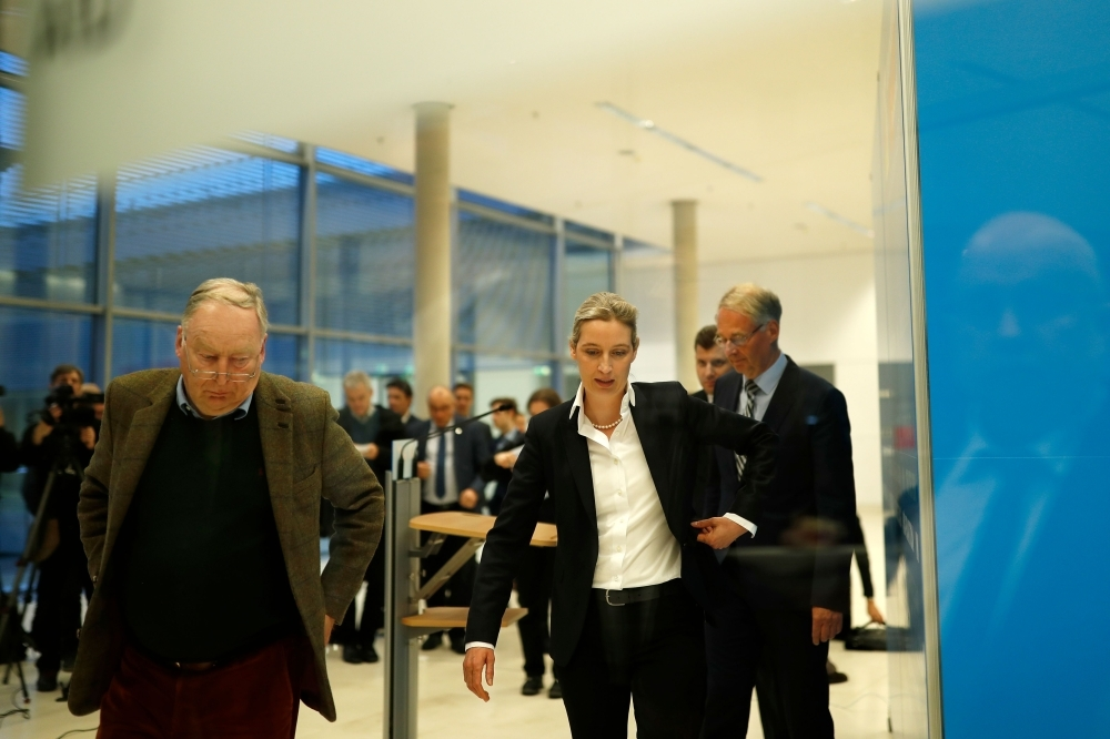 Co-leader of the Alternative for Germany (AfD) far-right party Alexander Gauland, left (L) and AfD parliamentary group co-leader Alice Weidel leave after press conference on plans of Germany's domestic intelligence agency BfV to place the party under surveillance in Berlin on Tuesday. — AFP