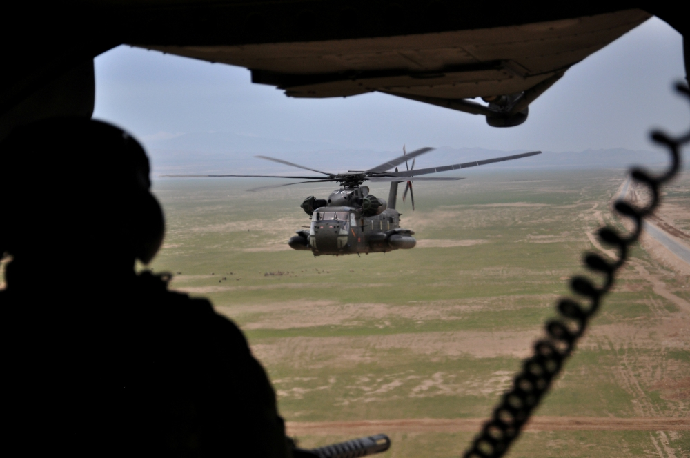 A soldier of the German armed forces Bundeswehr in a CH-53 helicopter on their way from Kunduz to Mazar-i-Sharif, Afghanistan, in this March 27, 2017 file photo. — Reuters