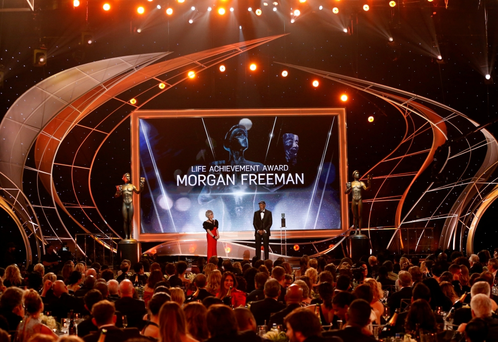 FILE PHOTO: 24th Screen Actors Guild Awards - Show - Los Angeles, California, U.S., 21/01/2018 - Actor Morgan Freeman accepts the Life Achievement Award from actress Rita Moreno. REUTERS/Mario Anzuoni/File Photo