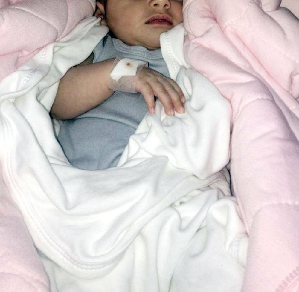 Deem Al-Al-Subaie, who contracted meningitis when her family visited a sick relative at Al-Khurma Hospital, receives treatment at Al-Yamamah Hospital in Riyadh.