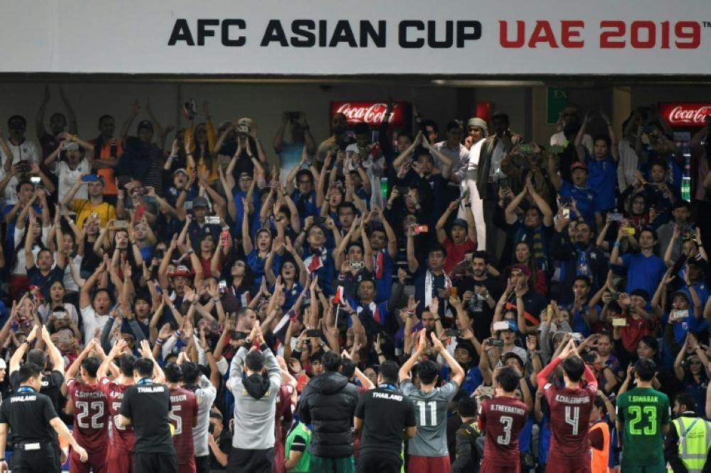 While some fans at the Asian Cup may not be familiar with the chant's origins, they make up for it in enthusiasm. — AFP