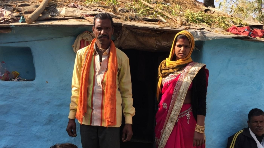 Makhanlal Ahirwal poses for a photo with his 16-year-old daughter Bhawani in Buxwaha, Madhya Pradesh, in this Dec. 12, 2018 file photo. — Thomson Reuters Foundation