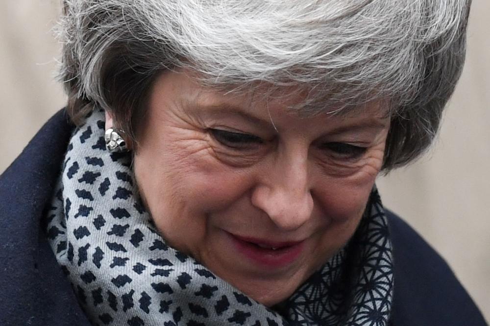 Britain's Prime Minister Theresa May leaves 10 Downing Street in London on Wednesday ahead of Prime Minister's Questions (PMQs) to be followed by a debate and vote on a motion of no confidence in the government. — AFP