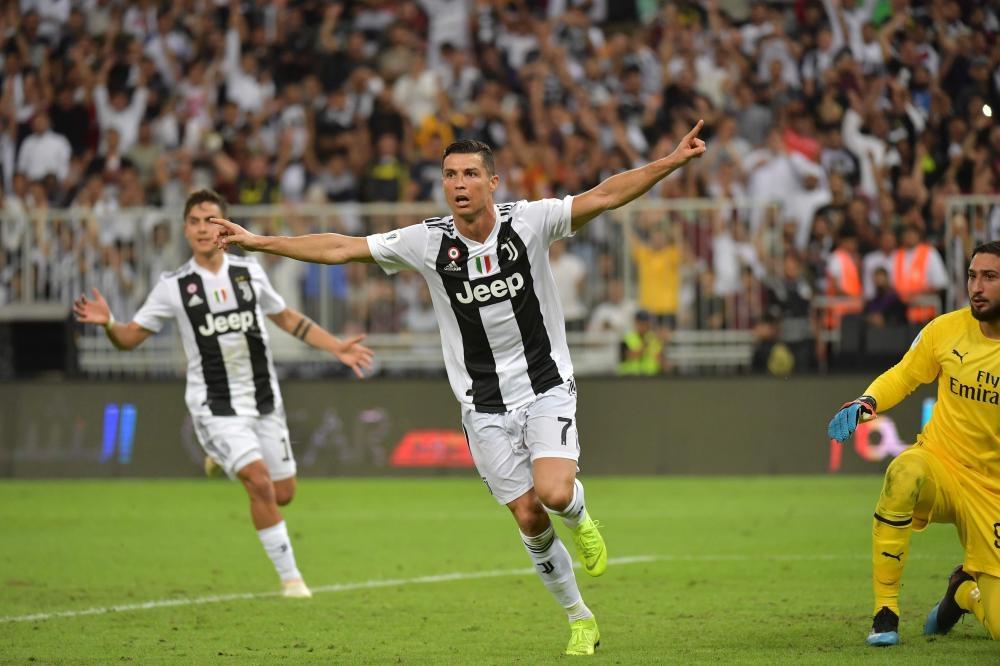 Juventus' forward Cristiano Ronaldo celebrates his goal during their Supercoppa Italiana final against AC Milan at the King Abdullah Sports City Stadium in Jeddah Wednesday. — AFP