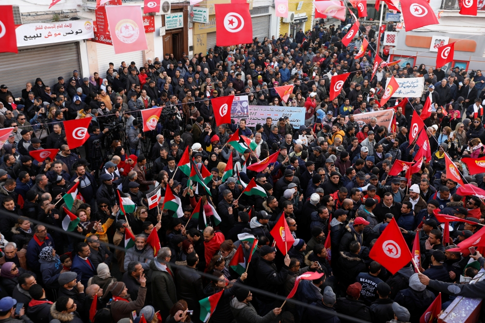 People gather during a nationwide strike against the government's refusal to raise wages in Tunis, Tunisia, on Thursday. — Reuters