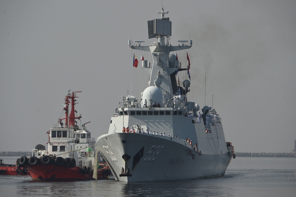 Chinese guided-missile frigate Wuhu prepares to dock at the international port in Manila on Thursday. — AFP