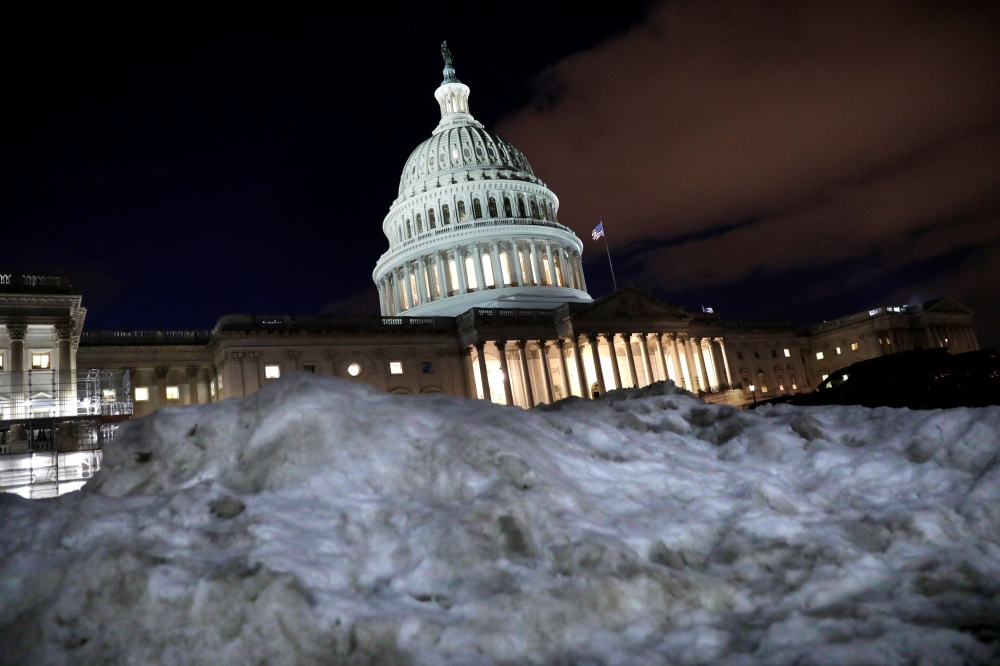 The U.S. Capitol is seen behind a snow pile in Washington, on Wednesday. — Reuters