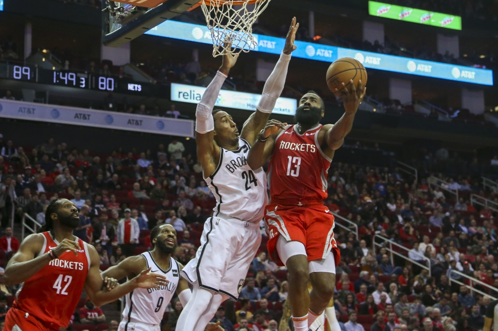 Houston Rockets guard James Harden (13) shoots a layup against Brooklyn Nets forward Rondae Hollis-Jefferson (24) during the third quarter at Toyota Center. — Reuters