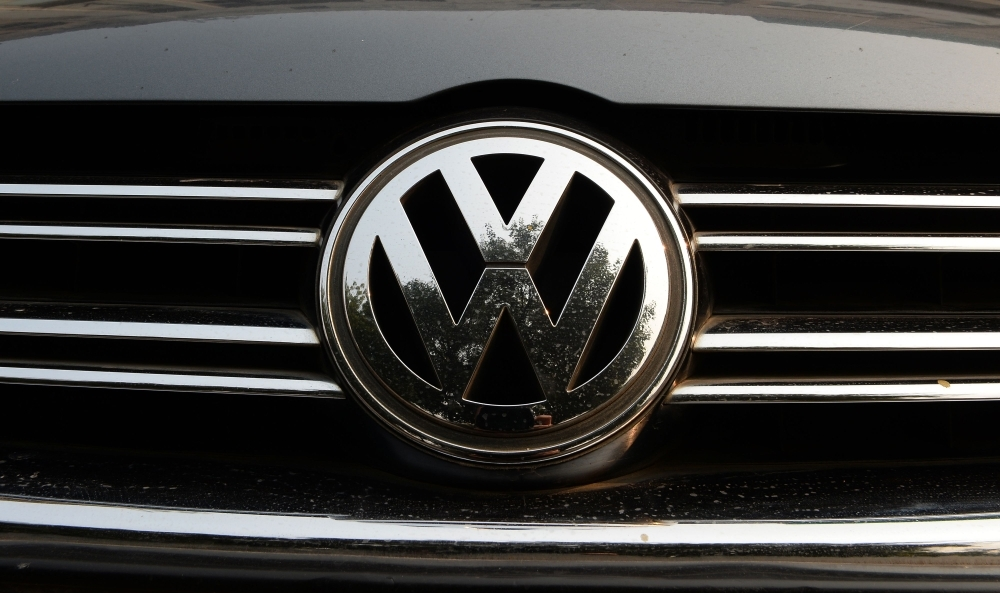A logo of German automaker Volkswagen is pictured in New Delhi on Thursday. India's environmental court gave 24 hours to German automaker Volkswagen to pay $14 million after holding it responsible for violating country's pollution norms by fudging emission devices. — AFP