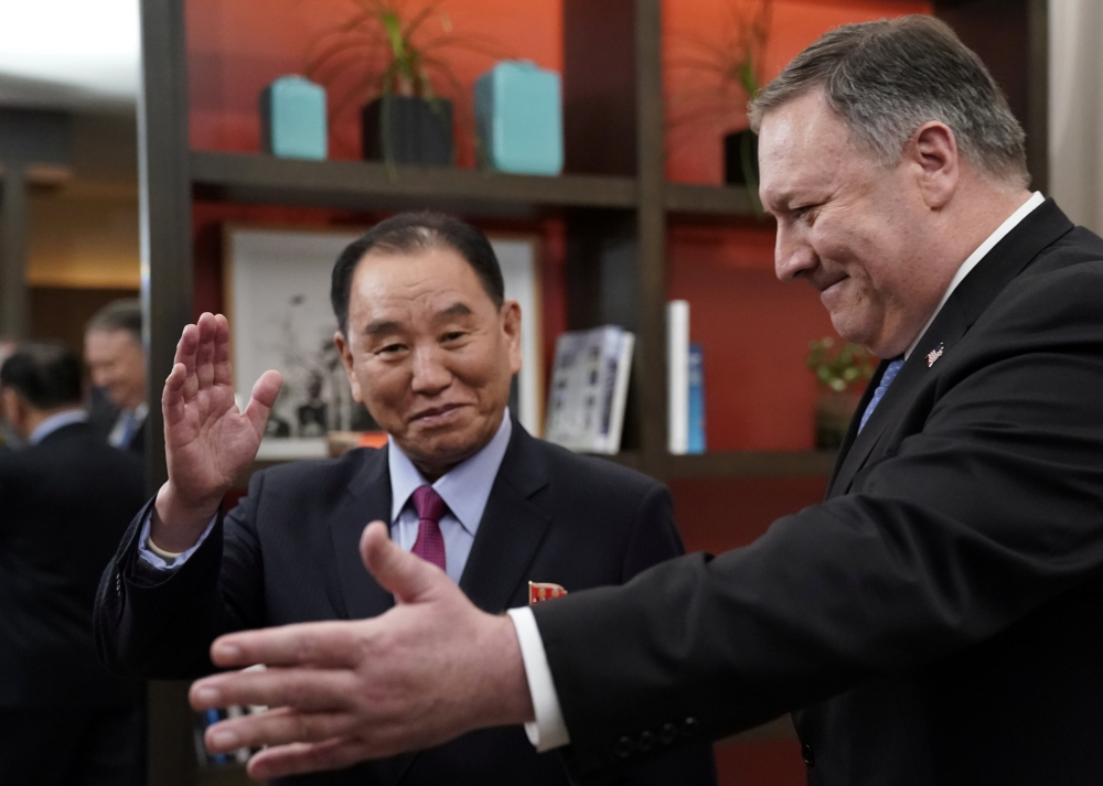 US Secretary of State Mike Pompeo stands with Vice Chairman of the North Korean Workers' Party Committee Kim Yong Chol, North Korea's lead negotiator in nuclear diplomacy with the United States, for talks aimed at clearing the way for a second US-North Korea summit as they meet at a hotel in Washington on Friday. — Reuters