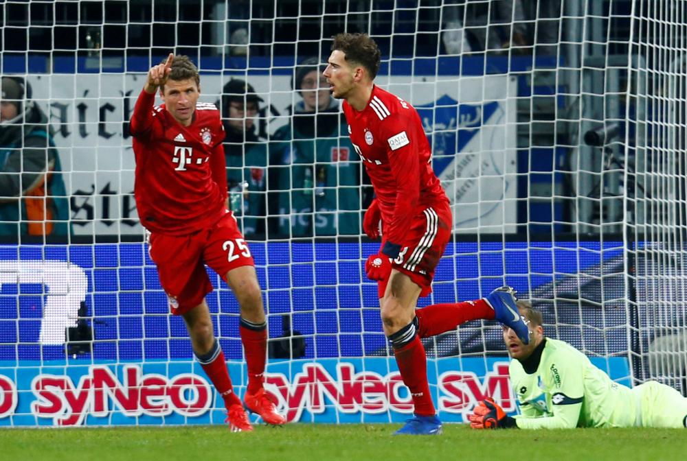 Bayern Munich's Leon Goretzka (R) celebrates scoring their second goal with Thomas Mueller against Hoffenheim during their Bundesliga match at PreZero Arena, Sinsheim, Germany, Friday. — Reuters