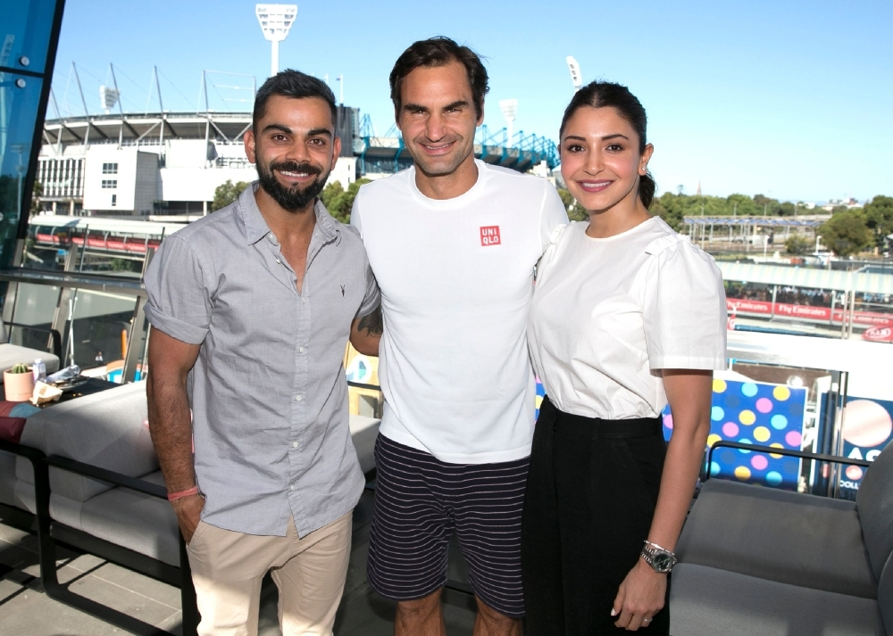 This photo shows Switzerland's Roger Federer (C) meeting Indian cricket captain Virat Kohli (L) and his wife Anushka Sharma (R) on day six of the Australian Open tennis tournament in Melbourne on Saturday. — AFP