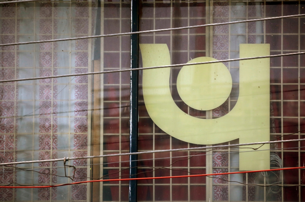 The logo of Punjab National Bank (PNB) is seen on a branch office window in New Delhi. — Reuters