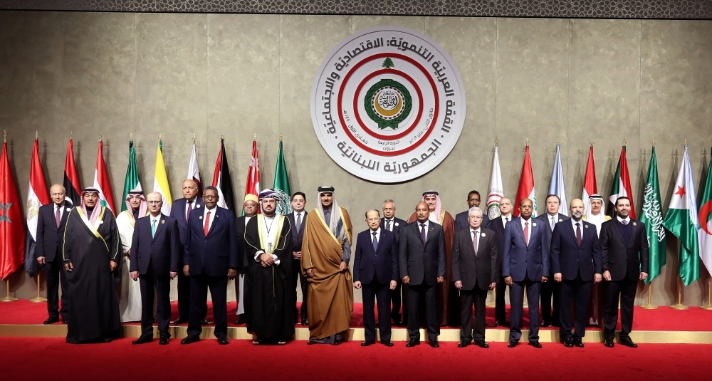 Arab leaders at the opening session of a regional economic summit in the Lebanese capital Beirut on Sunday. — AFP photos