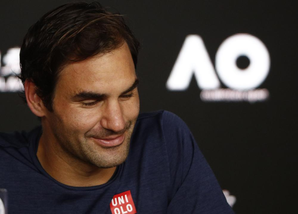Switzerland's Roger Federer attends a news conference after losing the match against Greece's Stefanos Tsitsipas at the Australian Open in Melbourne Sunday. — Reuters