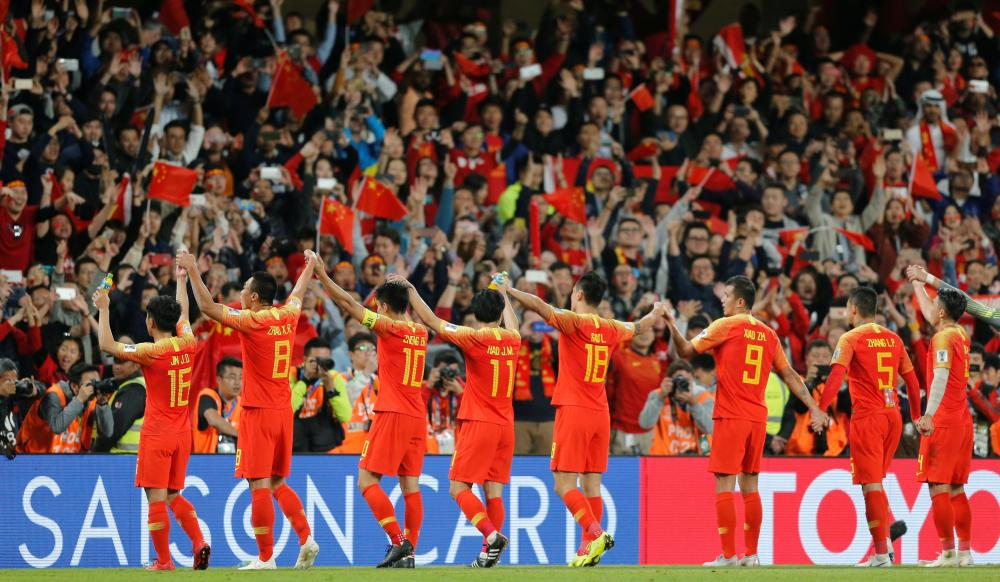 China's players celebrate at the end of the AFC Asian Cup match against Thailand at Hazza Bin Zayed Stadium in Al-Ain Sunday. — Reuters