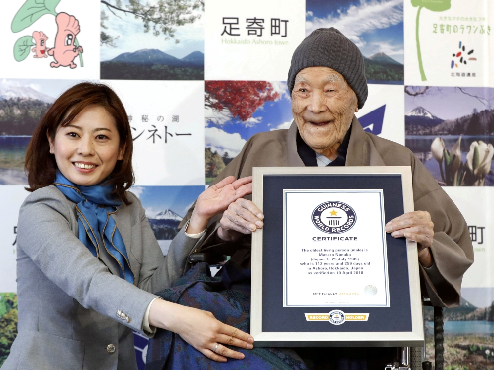 Japanese Masazo Nonaka, who was born 112 years and 259 days ago, receives a Guinness World Records certificate naming him the world's oldest man during a ceremony in Ashoro, on Japan's northern island of Hokkaido. — Reuters