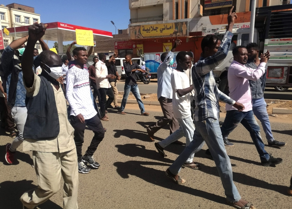 Sudanese demonstrators gather in Khartoum's twin city Omdurman on Sunday, where Sudanese police fired tear gas at protesters ahead of a planned march on parliament. — AFP