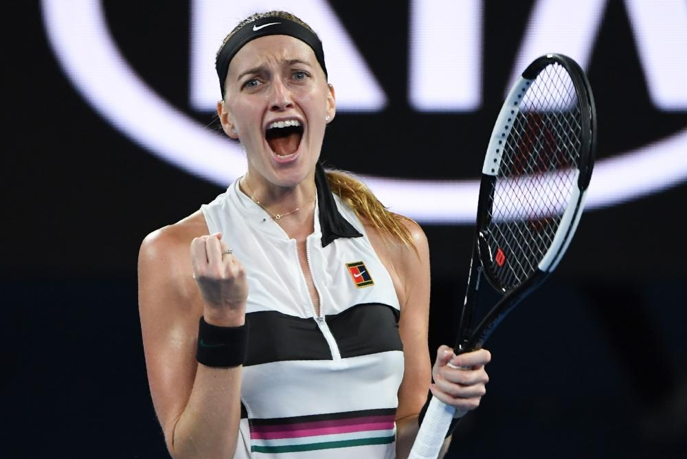Czech Republic's Petra Kvitova celebrates her victory against Australia's Ashleigh Barty at the Australian Open Tuesday. — AFP