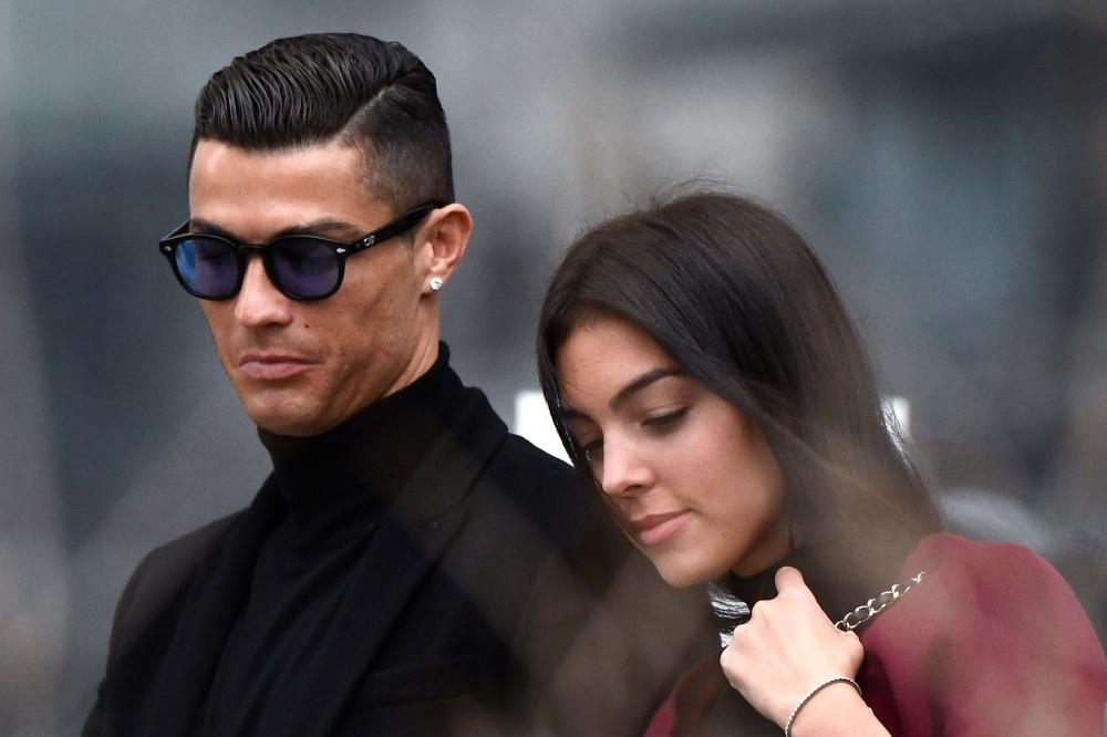 Juventus' forward and former Real Madrid player Cristiano Ronaldo leaves with his Spanish girlfriend Georgina Rodriguez after attending a court hearing for tax evasion in Madrid Tuesday. — AFP