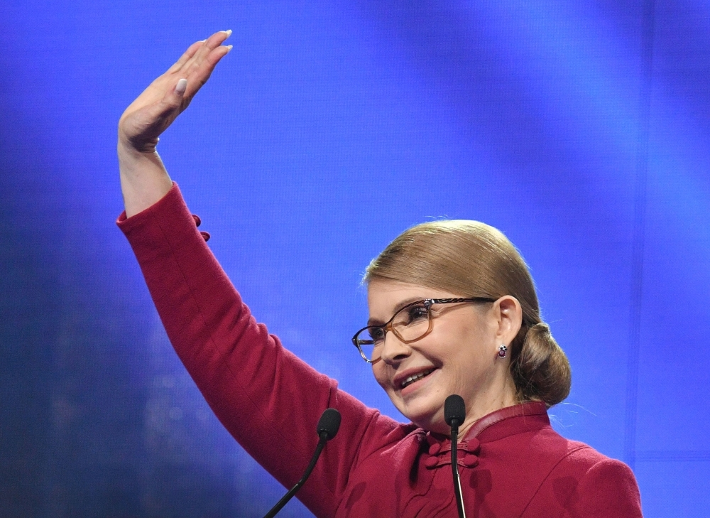 Former Ukrainian Prime Minister Yulia Tymoshenko greets supporters during a congress of her party Batkivshchyna (Fatherland) in Kiev on Tuesday. — AFP   Former Ukrainian prime minister Yulia Tymoshenko on January 22 officially launched her bid for the presidency, with polls showing her as the frontrunner for the country's top political post. Tymoshenko has been a leading figure on the Ukrainian political scene for the last two decades, coming to international prominence through her role in the 2004 Orange Revolution. / AFP / Genya SAVILOV