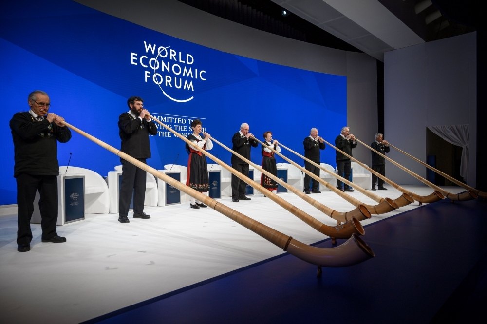 Alphorn blowers perform during the opening of the World Economic Forum (WEF) annual meeting on Tuesday in Davos, eastern Switzerland. — AFP