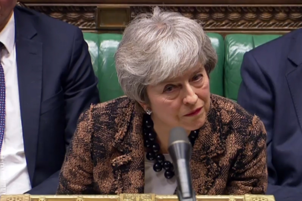 A video grab from footage broadcast by the UK Parliament's Parliamentary Recording Unit (PRU) shows Britain's Prime Minister Theresa May listening as opposition Labour party leader Jeremy Corbyn responds to her statement on changes to her Brexit withdrawal agreement, in the House of Commons in London on Monday. — AFP