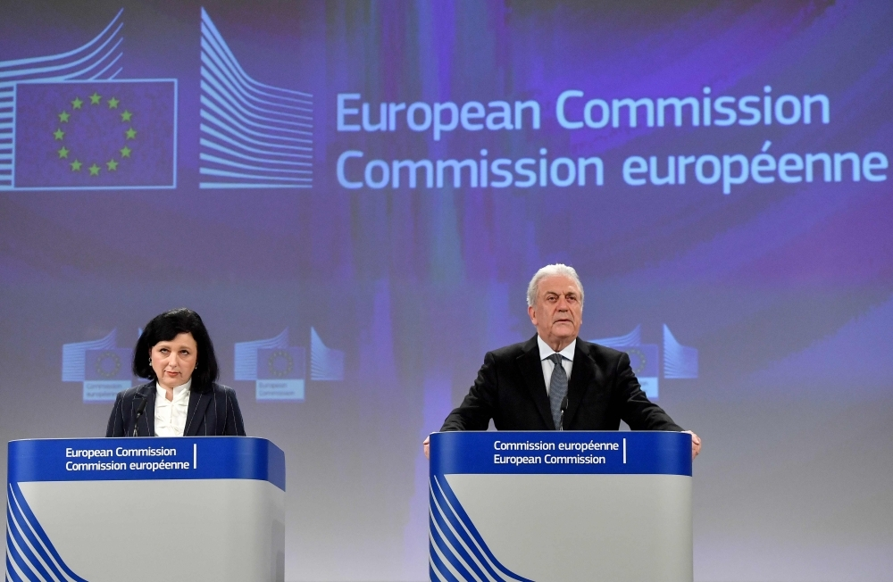 "European Commissioner for Justice, Consumers and Gender Equality Vera Jourova, left, and Commissioner for Migration, Home Affairs and Citizenship Dimitris Avramopoulos, right, give a press conference on the issue of the ""golden visas"" at the end of the college meeting at the European Commission in Brussels on Wednesday. — AFP"