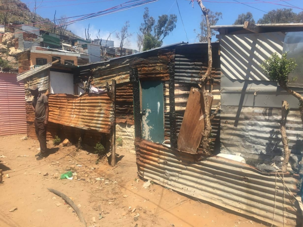 Shacks with walls damaged by fire are seen in the Imizamo Yethu settlement near Cape Town, South Africa, in this Oct. 25, 2018 file photo. — Reuters