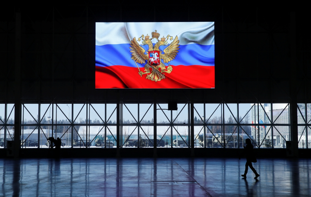 A view shows a screen displaying a flag with the Russian coat of arms during a news briefing, organized by Russian defense and foreign ministries and dedicated to SSC-8/9M729 cruise missile system, at Patriot Expocentre near Moscow, Russia, on Wednesday. — Reuters