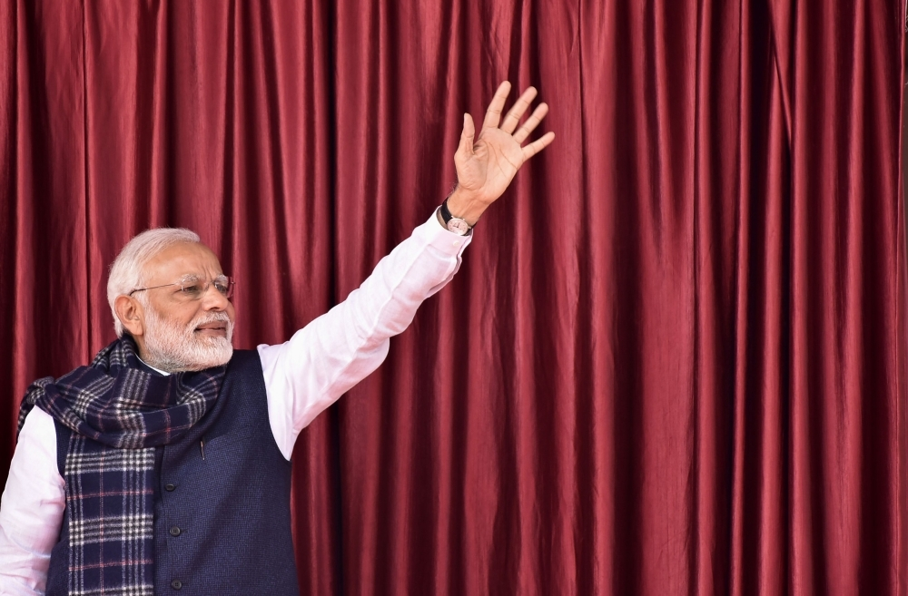 Indian Prime Minister Narendra Modi waves to the crowd during a campaign sweep through eastern Jharkhand state to inaugurate development projects in this Jan. 5, 2019 file photo. — AFP