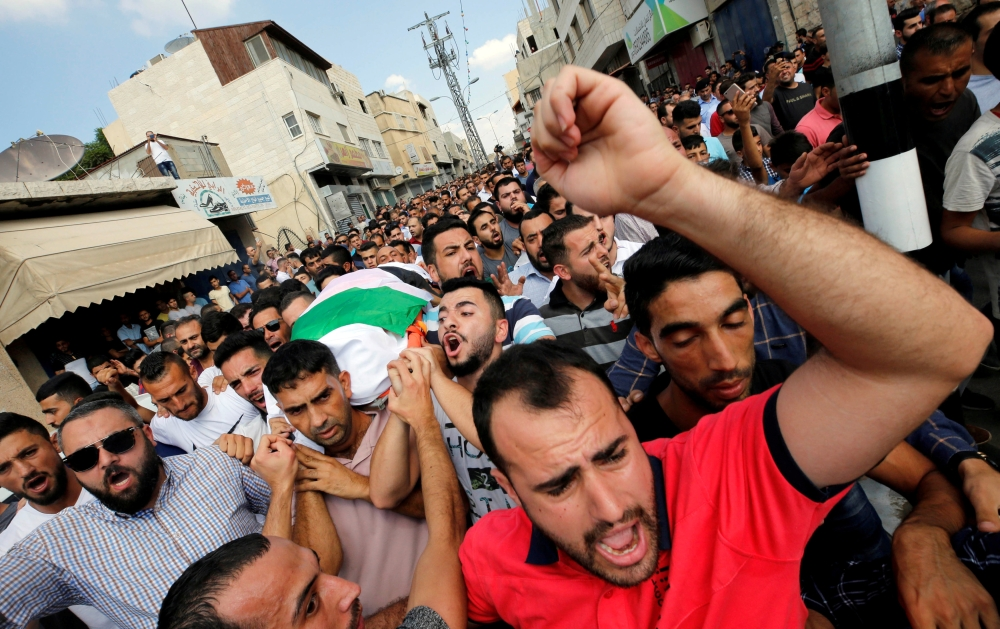 Mourners carry the body of Palestinian woman Aisha Al-Rawbi during her funeral in the town of Biddya near Nablus in the occupied West Bank in this Oct. 13, 2018 file photo. — Reuters