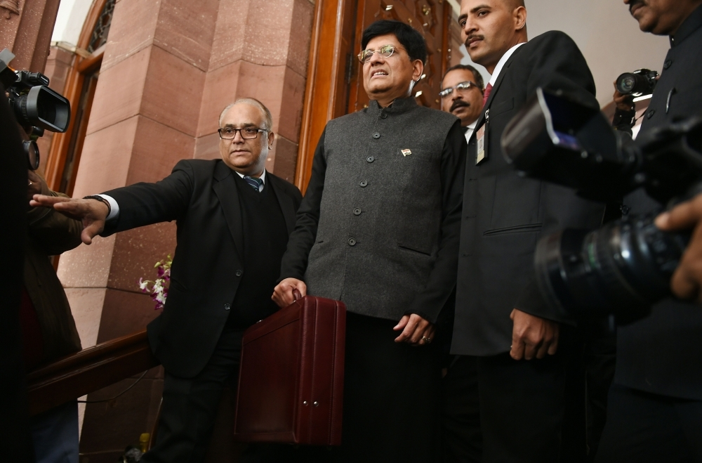 Indian Finance Minister Piyush Goyal (C) arrives at parliament to present the budget in New Delhi on Friday. — AFP