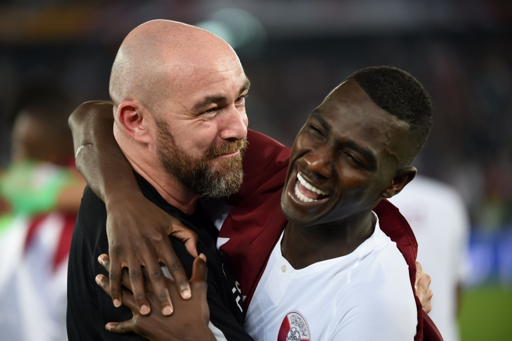 Qatar's forward Almoez Ali, right, celebrates with Qatar's coach Felix Sanchez after winning the 2019 AFC Asian Cup final at the Mohammed Bin Zayed Stadium in Abu Dhabi on Friday. — AFP