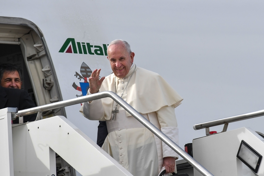 Pope Francis waves as he boards a plane at Fiumicino airport on his way to a three-day visit to the United Arab Emirates. — AFP    The United Arab Emirates prepares to warmly welcome Pope Francis, marking the first ever papal visit to the Arabian Peninsula.  / AFP / Tiziana FABI