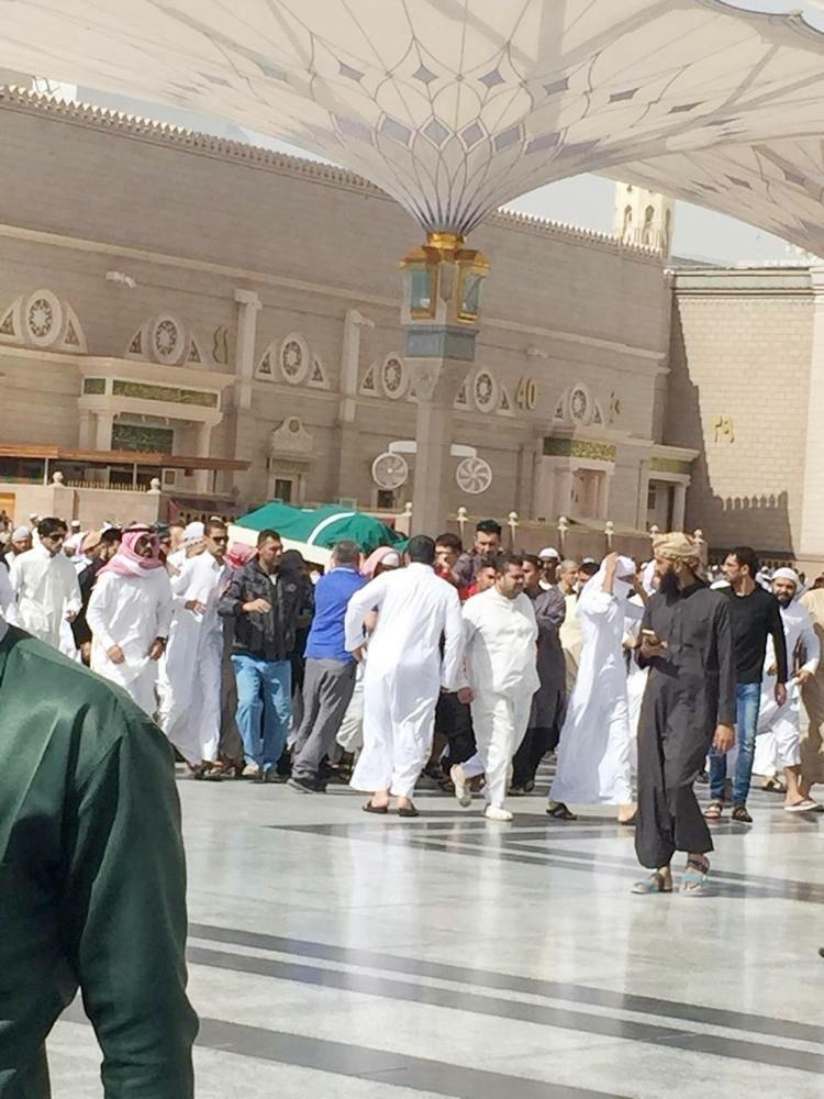 Relatives carry the body of the boy to the cemetary after funeral prayers at the Prophet's Mosque.