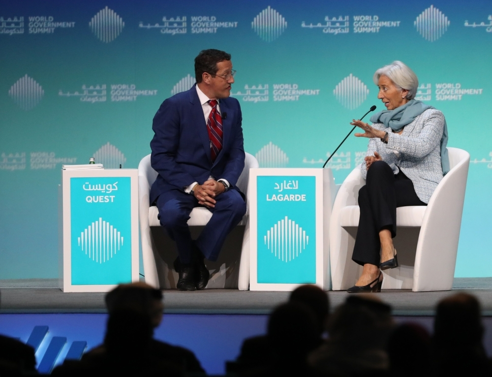 Christine Lagarde (R), Managing Director and Chairwoman of the International Monetary Fund, speaks to journalist Richard Quest. — AFP